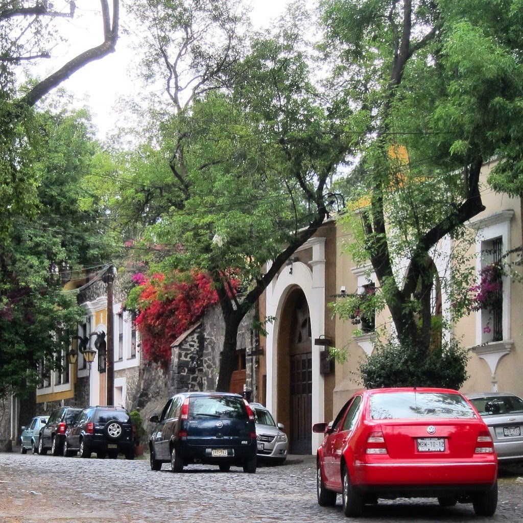 San Angel. A place where old-money resides in Mexico City. Worth a look. Completely safe, but still an entirely Mexican vibe. Hardly any foreign tourists around there.